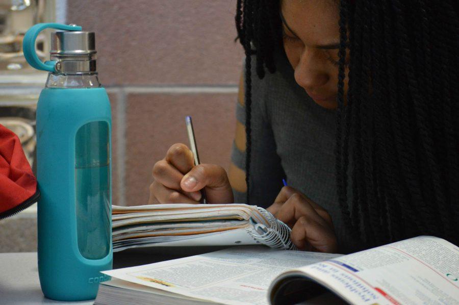 Head+bent+over+her+psychology+homework%2C+Keyana+Pollard+works+in+the+science+hall.