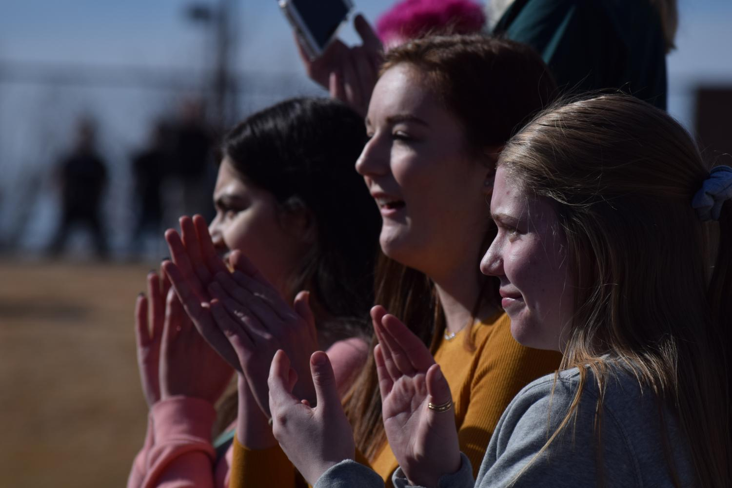 Emily Berton, Ramsha Ahamad, and Brooke Pantaleo cheer on the sea of students after a heartfelt speech at the CT Walk-out.