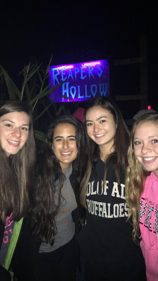 It+was+all+smiles+and+laughs+outside+of+Reapers+Hollow+last+year+until+the+screeching+of+the+solid+gates+were+opened+up+to+now+juniors+%28Left+to+Right%29+Ellie+Taylor%2C+Abby+Rios%2C+Carolyn+Letzig+and+Kelsey+Gessner.+%E2%80%9CThe+scariest+part+is+when+you%E2%80%99re+just+going+through+it+and+you%E2%80%99re+waiting+for+the+first+person+to+scare+you%2C%E2%80%9D+Taylor+said.+All+exclaimed+to+accelerated+heart+rates+and+screams+in+the+highly+rated+corn+maze.+Each+level+of+the+haunted+house+included+different+horrific+characters+to+stimulate+the+fear+in+every+guest+who+dared+to+enter.+%C2%A0%C2%A0%C2%A0