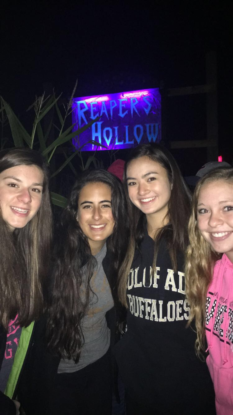 """It was all smiles and laughs outside of Reapers Hollow last year until the screeching of the solid gates were opened up to now juniors (Left to Right) Ellie Taylor, Abby Rios, Carolyn Letzig and Kelsey Gessner. """"The scariest part is when you're just going through it and you're waiting for the first person to scare you,"""" Taylor said. All exclaimed to accelerated heart rates and screams in the highly rated corn maze. Each level of the haunted house included different horrific characters to stimulate the fear in every guest who dared to enter."""