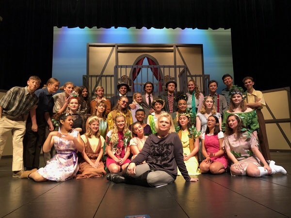 After months of hard work and rehearsals, the cast of A Midsummer's Night Dream gathers before a completed set, anxious for opening night.