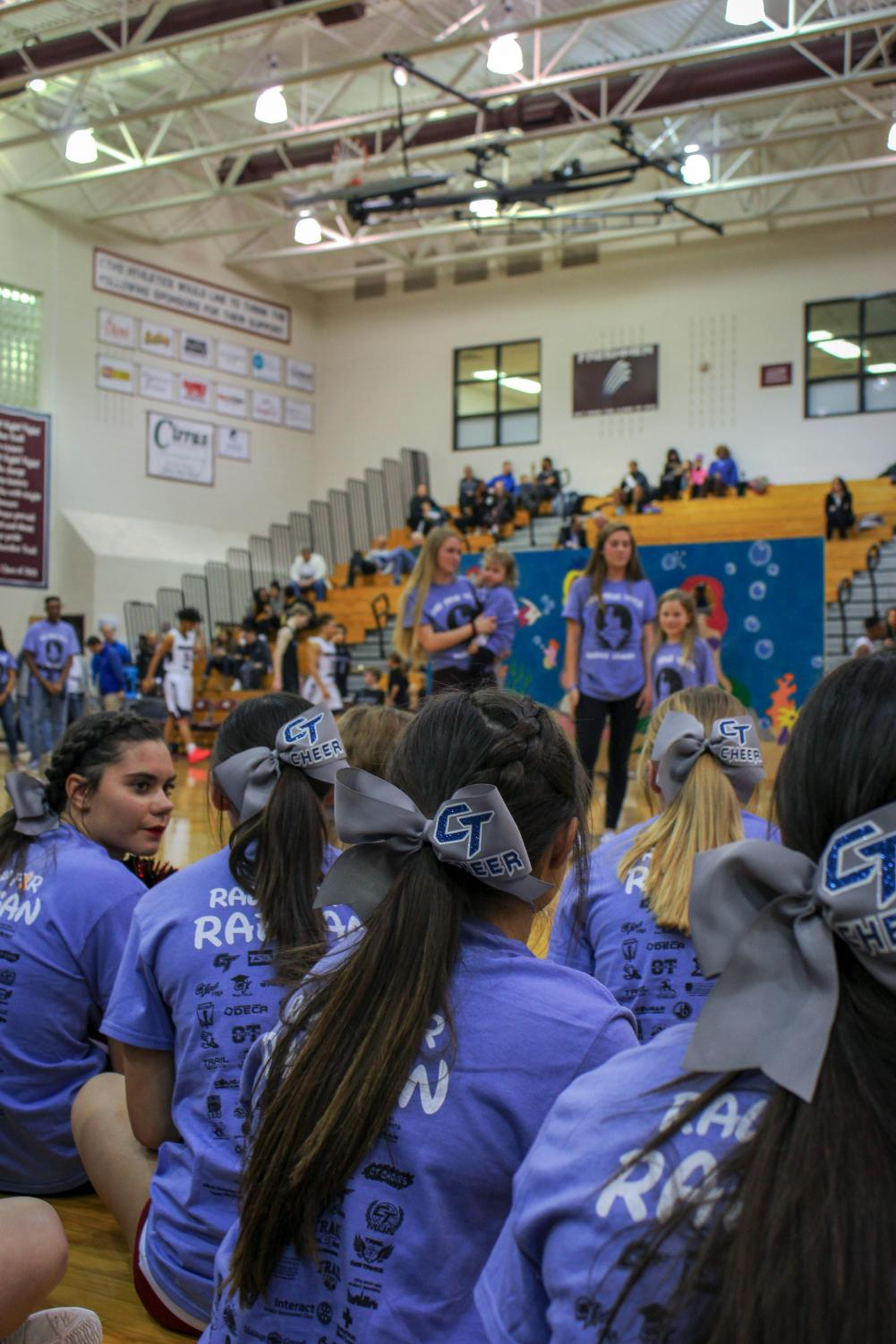 People who participated in the reveal, including the cheer team, gathered during halftime in purple shirts for the reveal of Cherokee Trail's 2019 wish kid. Students and staff who had a Wish Week shirt on, pre-ordered them and had to strategically hide their shirt until halftime when Raegan and her family could see all of Cherokee Trail united.