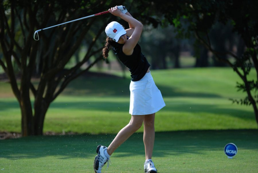 A+North+Central+College+golfer+tees+off+with+an+iron+at+the+NCAA+Women%E2%80%99s+Golf+Championship+in+2011.+