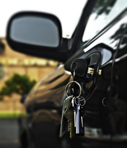 """Car keys dangle from the door handle of a sedan, much like Anna Cameron (11)'s car, where she stores her stuff during the school day. """"If I stay organized and know exactly what I need that day, I never really need to carry much around all the time.  If I stay organized and know exactly what I need that day, I never really need to carry much around all the time,"""" said Cameron about the advantages of using her car as a storage space for all her school materials. Photo by House of Joy Photos (CC BY-SA 2.0)"""