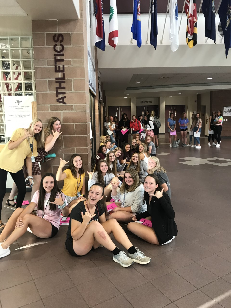 "Grinning from ear to ear, hopeful junior Powderpuff applicants are camped outside the Athletics office, patiently waiting for the doors to open and their applications to play in the one-time fall event to be accepted. ""It's a fun way to get involved in school and something that's competitive,"" said Mia Thorn (11). ""We typically get super caught up in winning, yet it's for a greater cause, and it brings our school together during homecoming week."" Girls began filing in as early as 6:30 before school to secure their spot in line, following the application process' accordance with ""first come, first serve"". In past years, the Powderpuff theme has ranged from veterans to breast cancer support. Photo courtesy of Ms. Tammy Johnson"