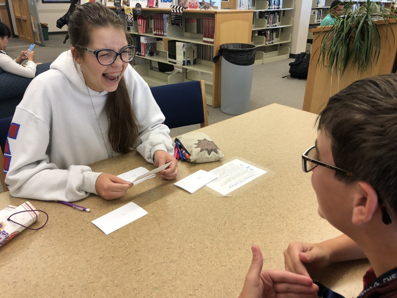 """Check it out. In order to study for their upcoming Spanish test, Madison Dragon (10) and Austin Elberg (10) work on flashcards in the library during the second week of school. """"I do homework in the library a lot and [the supplies] are always helpful for getting things done,"""" Dragon said."""