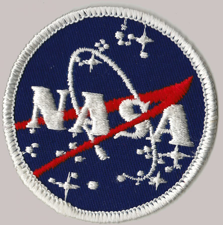 The+NASA+badge+glints%2C+illuminating+the+bold+red+and+blue+threads+of+the+nation%E2%80%99s+premiere+space+exploration+agency%E2%80%99s+emblem.+The+patriotic+colors+of+the+logo+are+emphasized+after+the+first+all+female+space+walk.