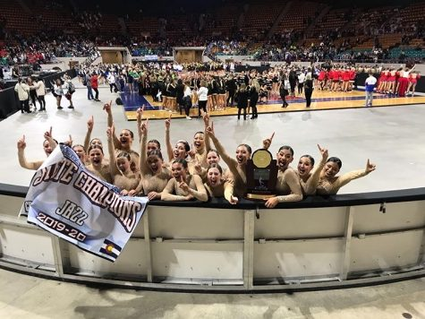 "Victory! The poms team celebrates their first state title in jazz. """"Everyone was cheering us on,""  Emarie Rodriguez (12) expressed. Their groundbreaking choreography shocked not just everyone in the audience but the other competitors as well."