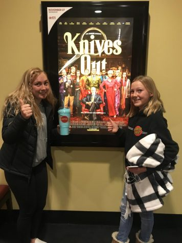 Popping two thumbs up for Knives Out, the latest crime drama in theaters this past week, Elyse Sommer and her youngest sister smile in front of the promotional poster at AMC Southlands before viewing the film.  The movie, originally written by Agatha Christie as a novel, features Daniel Craig (007 extraordinaire), Chris Evans (did someone say Captain America?), and Ana de Armas (another former James Bond star) in a set straight from a historic Victorian melodrama.