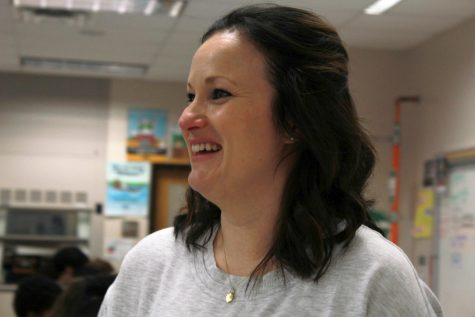 "While speaking with a student, Ms. Julie Scheffel smiles and laughs. ""The most rewarding moments are when a student emails me after they graduate, and they realize [taking AP Chem] was worth it,"" said Scheffel."