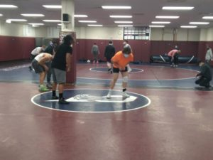 Cherokee Trail's wrestling team is warming up to start practice on Mar. 4, one day before Region 2's regional match which was hosted by CT.