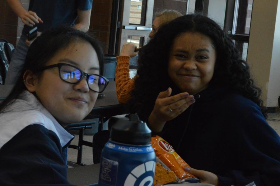Sonya Pritchard (9) and friends laugh at a joke while eating their typical lunch of chips in the cafeteria.