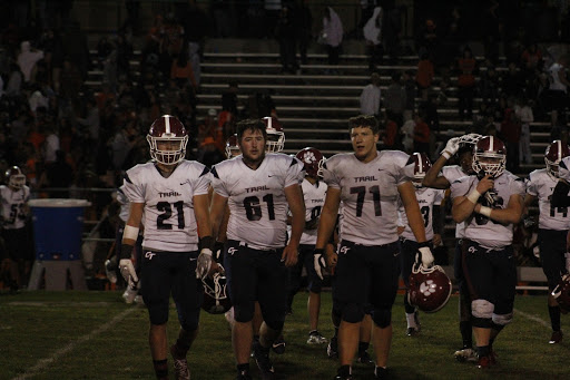 Strutting onto the field before the game, the varsity football players look determined - jaws set and eyes focused. Many high school players dream of an opportunity to play Division 1 in college, but how will this new idea shift the process?  Photo by Thomas Wynne