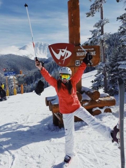 Senior Delaynie Treat jumps for joy at the top of the ski slope. I go up about five times a season, but I wish I could go more, said Treat.