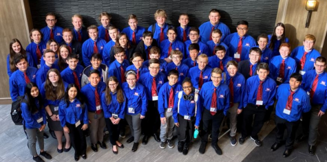 """Go team.  As the state competition ends, the school's team competitors huddle together for one last photo. """"This weekend was very successful for CT. We took first place in multiple events,"""" Jake Zellmer (10) said."""