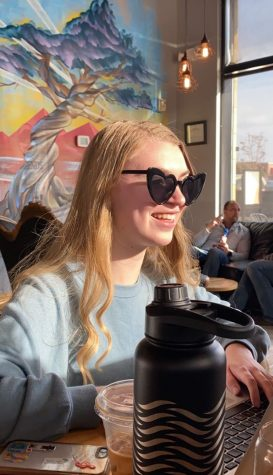 "Unaware of the news that was soon to be announced, Emma Holman (12) shares a laugh with her friends after school at Legends Coffee on Thursday March 12. After hearing about school being canceled Homan expressed, ""I'm so sad that my time with my classmates and friends has been cut short and will miss the class days that I shared with my peers. Overall, I feel like our senior year has a pretty unsatisfying end."" School is planned to resume on April 17, yet many seniors have already mentally prepared for the event in which school is canceled for the remainder of their final year."