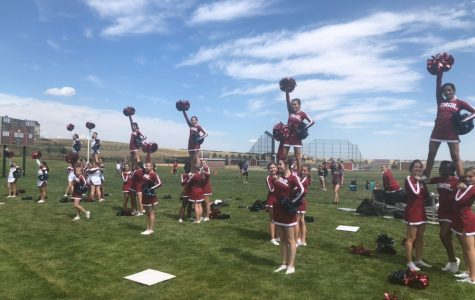 Cheerleaders, dancers, and gymnasts prove they are more than just a sport. CT cheerleaders hold preps during football season, demonstrating upmost athletic ability. Photo courtesy of Pamela Semple.