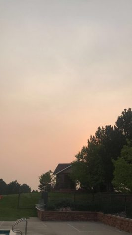 "The gradient between smoky air and clear skies is visible above Tallyn's Reach pool on Sept. 7. ""As a lifeguard the fires have impacted me negatively because it makes it really difficult to work outside when I am constantly inhaling the ash and smoke,"" said Gabby Burns (12). Burns is a lifeguard who works at Tallyn's Reach and finds that the atmosphere has been murky for the past few months in a way she's never seen before."
