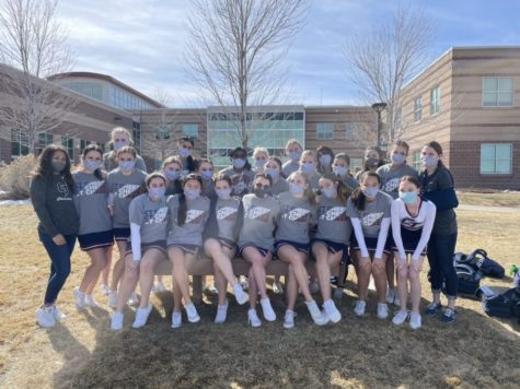 Before their first performance at Rock Canyon High, Cherokee Trails junior varsity cheer team poses for the camera. Under this mask, Im smiling, trust me, Joy Martin (9) said. The cheerleaders then completed their first routine of the season in front of a panel of judges.