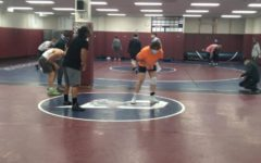 Cherokee Trails wrestling team is warming up to start practice on Mar. 4, one day before Region 2s regional match which was hosted by CT. Some changes I had to do were practice harder and longer with having matches go by faster. I had to switch up my warm up, says Derek Glenn Jr. (11), State champion searching to return to the podium once again. That weeks practice, along with all season soon showed to pay off, during the next two days of competition.