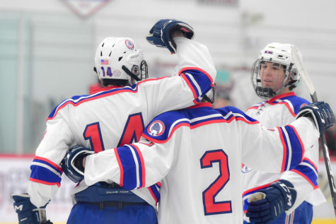 Nothing like celebrating together through these times of seperations. At the home game against Chaparral on Feb. 5, the team celebrates after scoring a goal. Seeing and talking to my teammates every day and just playing games is super fun, said Aidan Tucker (12).