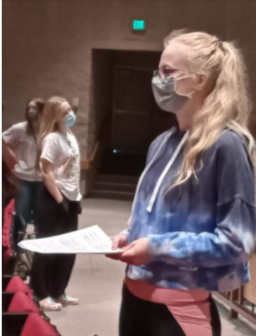"""A choir student prepares to sing behind the confinement of a mask. """"Choir has really given me a family to go to whenever I need someone. Everyone is so supportive and being in choir has just improved my life in so many ways,"""" Ekstorm stated."""